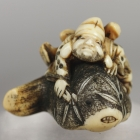 Ebusa, God of Fishery, on Hunch-back Fish Netsuke