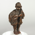 Man Carrying Sack with Oni in It, Netsuke