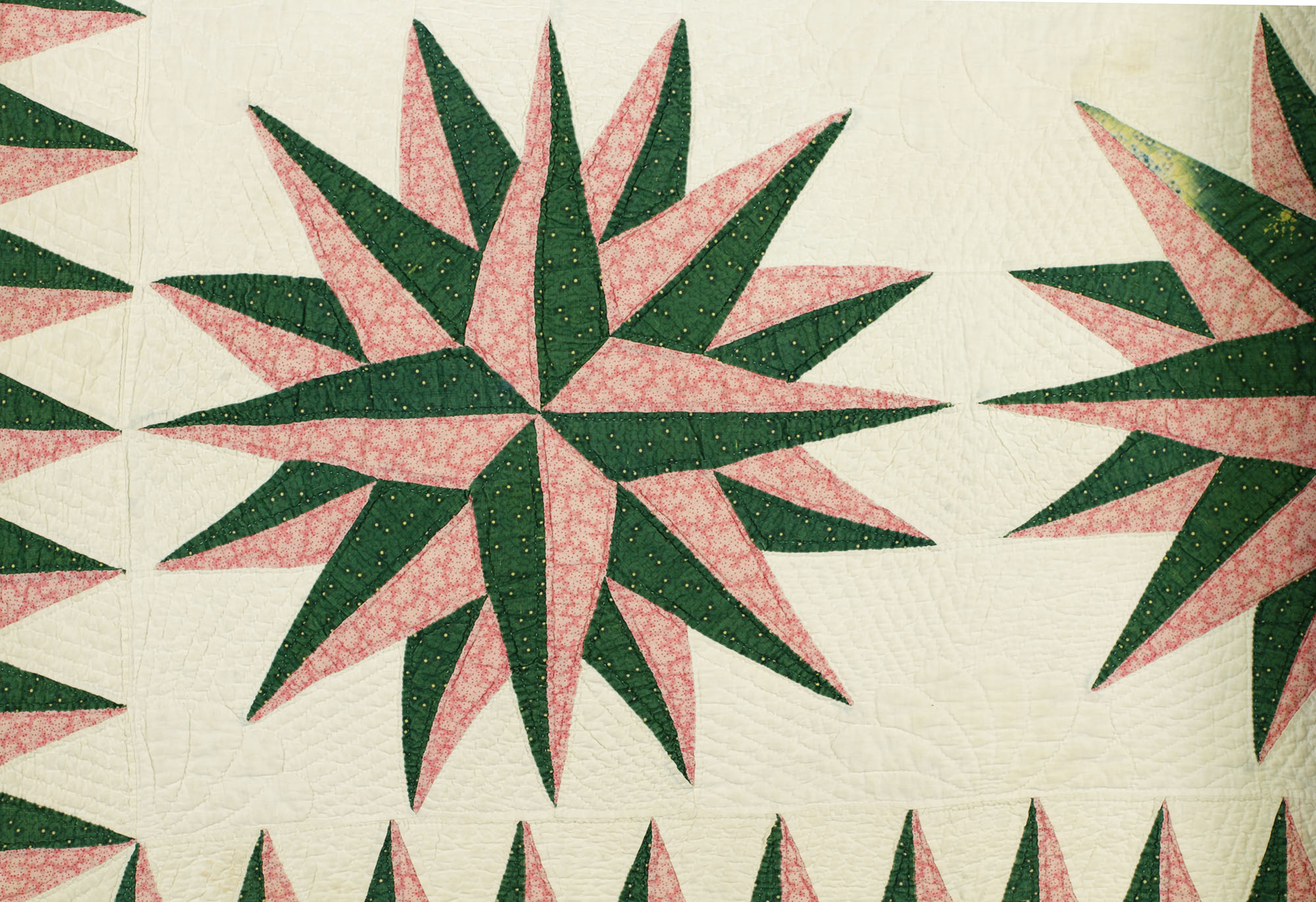 tl_files/pages/collections/Exhibition Banners/u1978.163.2_detail_Quilt.jpg